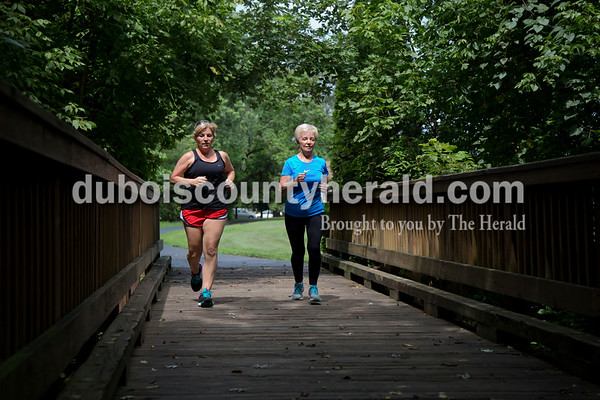 Sarah Shaw/The Herald Lenani Wittwer of Jasper, right, and her daughter Candy Berger also of Jasper ran along the Jasper Riverwalk in Jasper on Thursday. Wittwer, 71, only began running three years ago and has finished 17 races so far in 2016.