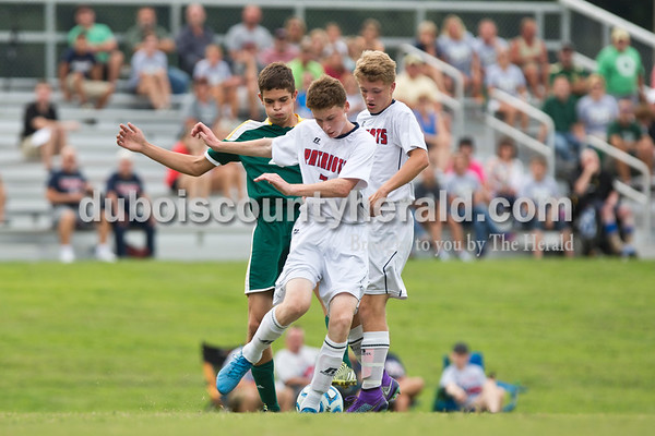 Forest Park's Blake Mohr and Heritage Hills' Cole Mulzer and Zeke Wittman fought for the ball during Tuesday evening's soccer game at Heritage Hills High School in Lincoln City. Heritage Hills beat Forest Park 5-0. Sarah Ann Jump/The Herald