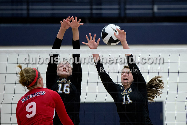 Sarah Shaw/The Herald Jasper's Riley Merder and Jocelynn Morrow struggled to defend after Heritage Hills' Sydney Scherry spiked the ball over the net during the game at Heritage Hills High School in Lincoln City on Tuesday. The Patriots beat the Wildcats three sets to none.