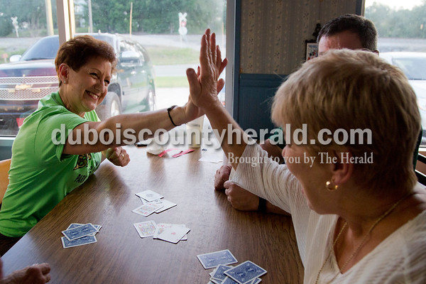 Sarah Shaw/The Herald Janice Brown of Eckerty and Brenda Knies of Birdseye celebrated after winning a round during the Euchre tournament at Deb's Truck Stop in Birdseye on Thursday.
