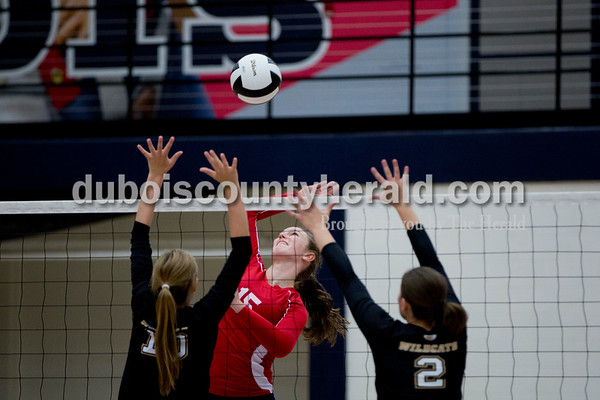 Sarah Shaw/The Herald Heritage Hills' Abby Wahl spiked the ball over the net while Jasper's Avery Bell and Maddie Edwards defended during the game at Heritage Hills High School in Lincoln City on Tuesday. The Patriots beat the Wildcats three sets to none.