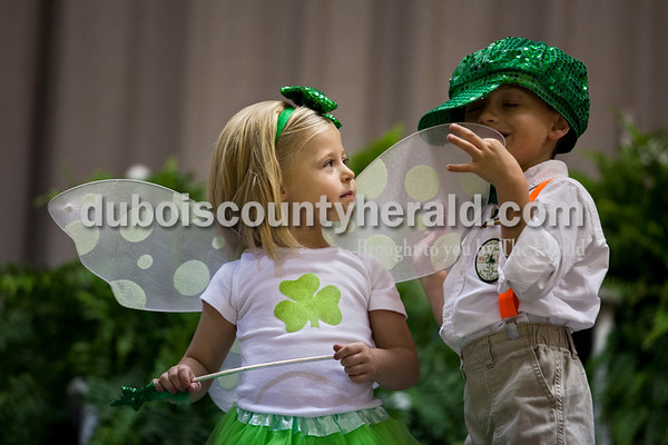 Olivia Lampert of Ireland, 4, looked up at Cash Gehlhausen of Ireland, 4, as Cash played with her wings during the Ties and Tutu's program at the Ireland Bicentennial pageant on Sunday afternoon at Ireland Elementary School.  Alisha Jucevic/The Herald