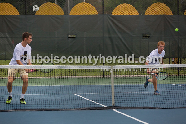 Sarah Shaw/The Herald Jasper's Bryce Siegel and Noah Luebbehusen played a doubles match against Castle during the tennis invitational in Jasper on Saturday.
