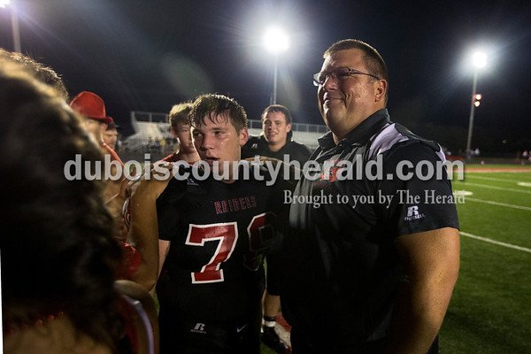 Southridge's Sam White thanked Coach Scott Buening after Friday night's game in Huntingburg. The Raiders defeated the Wildcats 28-21, securing the first rivalry win since 2008.  Alisha Jucevic/The Herald
