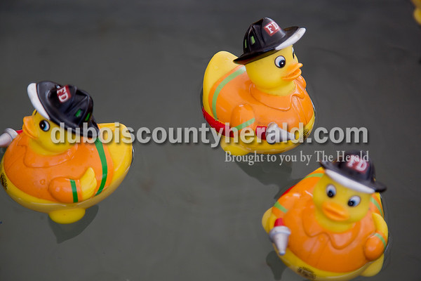 Sarah Shaw/The Herald Firemen-themed rubber ducks were used in a carnival game during the St. Anthony Firemen's Fest in St. Anthony on Saturday. Children could pick a duck and win a prize depending on the duck's number.