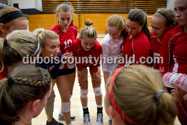 Sarah Shaw/The Herald Heritage Hills' coach Haley Taylor, left, encouraged her players after the end of the first set during the game against Jasper at Heritage Hills High School in Lincoln City on Tuesday. The Patriots beat the Wildcats three sets to none.