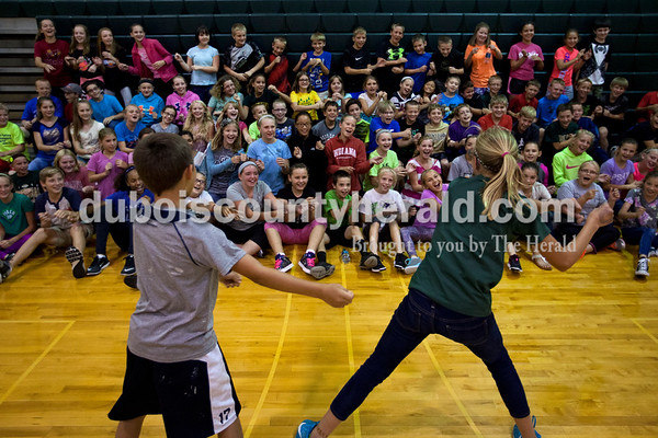 """Cedar Crest Intermediate School fifth-grader Sage Stout and sixth grader Lydia Betz led their classmates in the roller coaster cheer before the student spread out on the gym floor to watch """"Inside Out"""" on Monday afternoon in Bretzville. As a prize for completing all 25 bingo squares in their summer reading program, 100 students qualified for pizza and a movie after school. Librarian Dorothy Buechler said the program gave the students new and interesting ways to incorporate reading into their summer. The squares included things like reading a comic book or poem, listening to an audio book, reading a newspaper article and reading chapter books.  Alisha Jucevic/The Herald"""