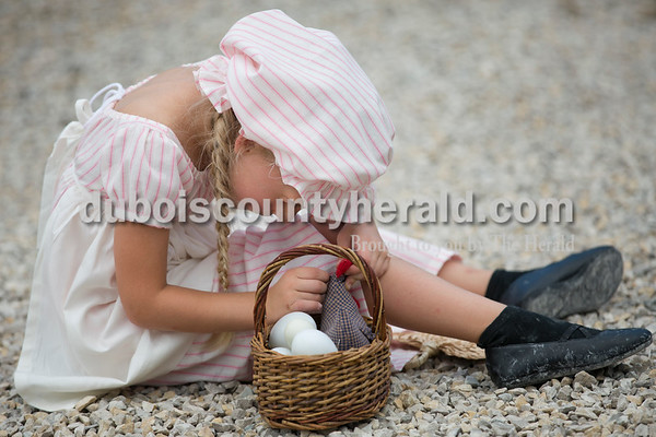 Maria Buechler of Jasper, 5, played with a sewn chicken before the Old Irish Fashion Show during the Ireland Bicentennial celebration Friday evening. Sarah Ann Jump/The Herald