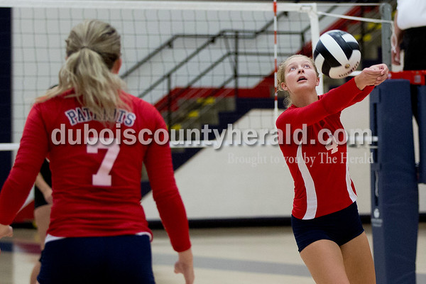 Sarah Shaw/The Herald Heritage Hills' Abby Wetzel volleyed the ball over the net during the game against Jasper at Heritage Hills High School in Lincoln City on Tuesday. The Patriots beat the Wildcats three sets to none.