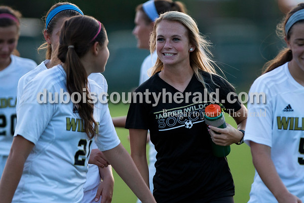 Jasper's Madisyn Hunt chatted with teammates after Thursday night's game against Princeton in Jasper. The Wildcats swept Princeton 9-0.   Alisha Jucevic/The Herald