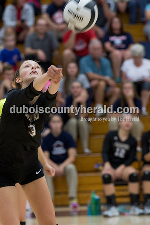 Sarah Shaw/The Herald Jasper's Libby Bell volleyed the ball during the game against Heritage Hills at Heritage Hills High School in Lincoln City on Tuesday. The Patriots beat the Wildcats three sets to none.