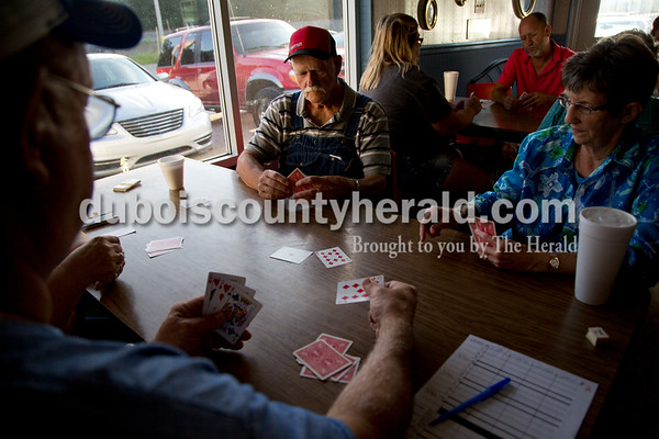 Sarah Shaw/The Herald Larry Ingle of Eckerty, from left, Herald Allen of Taswell, and Jo Ann Underhill of St. Croix played Euchre during the tournament at Deb's Truck Stop in Birdseye on Thursday. The Birdseye Picnic begins Friday afternoon and continues through Saturday.