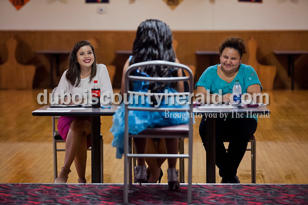 Evelyn Rivas of Huntingburg, left, Diana Rodriguez of Dale, not pictured, and Maria Remirez of Hutningburg, interviewed Camila Abarca of Huntingburg, 7, during the Latino Festival pageant interviews on Sunday afternoon at Teen Outback in Huntingburg. The pageant will take place after opening ceremonies on opening night of the festival, Sept. 2, at Huntingburg City Park. The festival will continue throughout Saturday.   Alisha Jucevic/The Herald