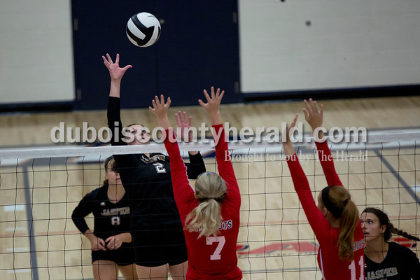 Sarah Shaw/The Herald Jasper's Maddie Edwards hit the ball over the net while Heritage Hills' Melissa Bell and Jessica Bertke defended during the game at Heritage Hills High School in Lincoln City on Tuesday. The Patriots beat the Wildcats three sets to none.