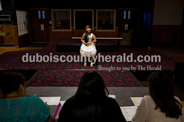Lupita Sanchez of Dale, 10, sat for her interview during the Latino Festival pageant interview sessions on Sunday afternoon at Teen Outback in Huntingburg. The pageant will take place opening night of the Latino Festival, Sept. 2, at Huntingburg City Park. The festival will continue throughout Saturday.   Alisha Jucevic/The Herald
