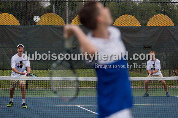 Sarah Shaw/The Herald Jasper's Bryce Siegel and Noah Luebbehusen watched as a Castle player served during the tennis invitational in Jasper on Saturday.