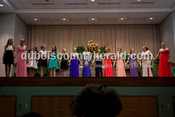 The Junior Miss and Miss Ireland Bicentennial Queen pageant contestants stood onstage together before the crown announcements on Sunday at Ireland Elementary School.  Alisha Jucevic/The Herald