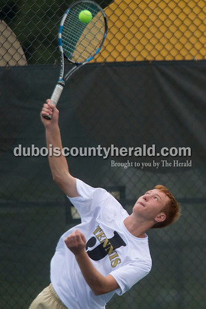 Sarah Shaw/The Herald Jasper's Noah Luebbehusen served during a doubles match against Castle at the tennis invitational in Jasper on Saturday.