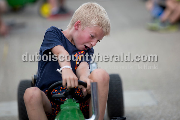 Sarah Shaw/The Herald Colson Healy of St. Anthony, 6, competed in the kiddie tractor pull during the St. Anthony Firemen's Fest in St. Anthony on Saturday.