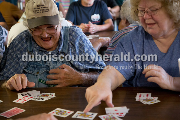Sarah Shaw/The Herald Buzo Goldman of West Fork and Brenda Brown of St. Croix joked while playing a round of Euchre during the tournament at Deb's Truck Stop in Birdseye on Thursday. The Birdseye Picnic begins Friday afternoon and continues through Saturday.