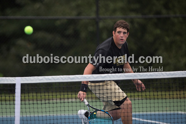 Sarah Shaw/The Herald Jasper's Eli Franks kept his eye on the ball during a match against Castle at the tennis invitational in Jasper on Saturday.