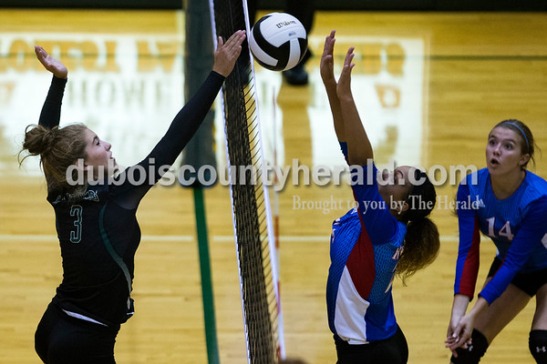 Forest Park's Faith Zazzetti spiked the ball over the net as South Spencer's Courtney Norman jumped to block during Monday night's game against South Spencer at Forest Park High School in Ferdinand. The Rangers fell 25-19, 19-25, 25-5, 25-19 to the Rebels.  Alisha Jucevic/The Herald