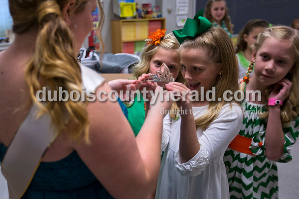 2015 Miss Shamrock Queen Nicole Kress of Ireland, 17, held out her crown for Little Miss contestants Andyn Lampert of Ireland, 8, left, Azleigh Young of Ireland, 10, center, and Layn Burger of Jasper, 9, to admire as the girls waited for the Little Miss and Mister Ireland Bicentennial pageant to begin on Sunday at Ireland Elementary School.  Alisha Jucevic/The Herald