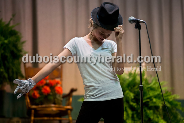 Junior Miss Ireland Bicentennial pageant contestant Kaitlyn Stenftenagel of Ireland, 13, struck a pose onstage dresses as Michael Jackson for the Bicentennial theme wear section of Miss Ireland Bicentennial Queen pageant on Sunday at Ireland Elementary School.  Alisha Jucevic/The Herald