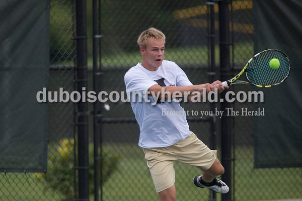 Sarah Shaw/The Herald Jasper's Andrew Schmitt hit the ball over the net during a doubles match against Castle at the tennis invitational in Jasper on Saturday.