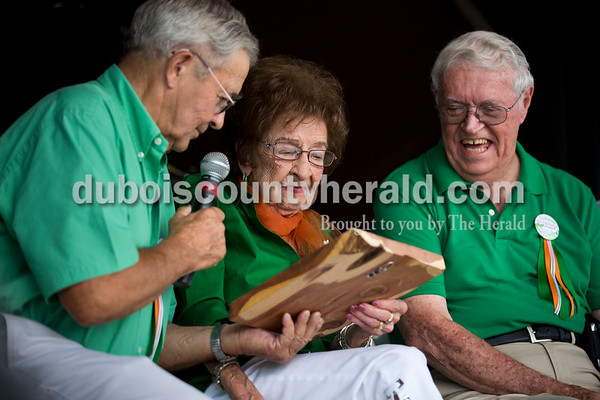 """Grand Marshal Delbert """"Junie"""" Himsel, left, presented Geneva Himsel, both of Ireland, with a declaration honoring her, as Grand Marshal Tom Kellams of Ireland looked on during the opening ceremony of the Ireland Bicentennial celebration Friday evening. Geneva Himsel, 100, graduated from Ireland High School in 1935 and is a life-long resident of Ireland. Sarah Ann Jump/The Herald"""