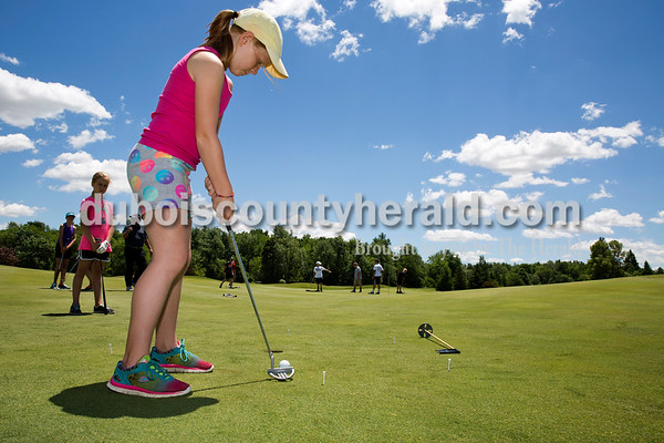 Sarah Ann Jump/The Herald Olivia Young of Jasper, 10, practiced putting during the City of Jasper Junior Golf Summer Camp at Ruxer Golf Course on Tuesday afternoon. She has been playing golf for three years.