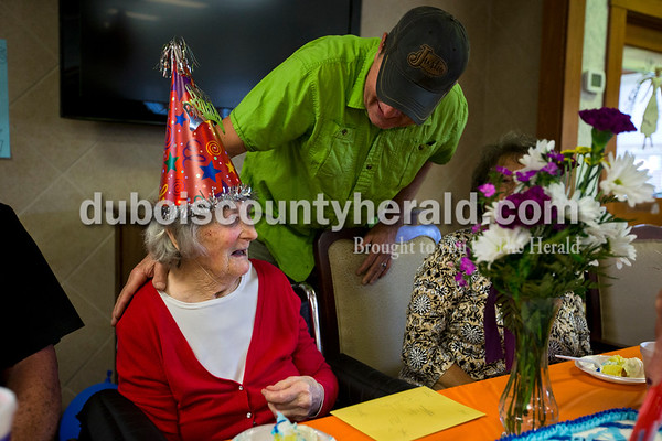 Dean Schnarr of Boone township greeted his aunt, Dorothy Shnarr, as residents and employees gathered together on Tuesday afternoon to celebrate Dorothy's 101st birthday at Northwood Retirement Community in Jasper. Schnarr was born on an 80-acre farm in Boone township and stayed on the property to work at the farm throughout her adult life. She lived with her niece and then her nephew for a few months, and then moved to Northwood at age 98. Her nephews Dean and Gary Schnarr of Boone township, and her niece Ruth Bush of Otwell remember her as a hard worker on the farm. The family raised hogs, cattle, and milk cows and farmed corn and soybeans. Dorothy always drove the tractor and Bush remembers seeing her aunt bouncing up and down when the tractor stalled going up the hills.  Alisha Jucevic/The Herald