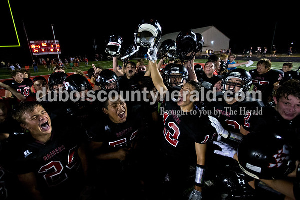 The Southridge Raiders celebrated their win after Friday night's game in Huntingburg. The Raiders defeated the Jasper Wildcats 28-21, securing the first rivalry win since 2008.  Alisha Jucevic/The Herald