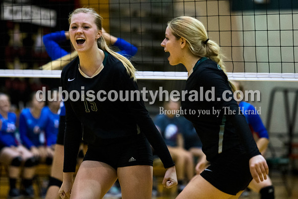 Forest Park's Courtney Borman, left, and Paige Seger, cheered on their team after making a point during Monday night's game against South Spencer at Forest Park High School in Ferdinand. The Rangers fell 25-19, 19-25, 25-5, 25-19 to the Rebels.  Alisha Jucevic/The Herald