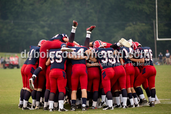 The Heritage Hills Patriots dove into a huddle before the start of the game against Tell City in Lincoln City on Friday. The Patriots beat the Marksmen 20-3.  Sarah Shaw/The Herald