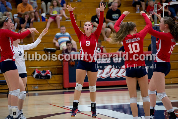 Sarah Shaw/The Herald Heritage Hills' Sydney Scherry, center, celebrated with her teammates after winning a point during the game against Jasper at Heritage Hills High School in Lincoln City on Tuesday. The Patriots beat the Wildcats three sets to none.