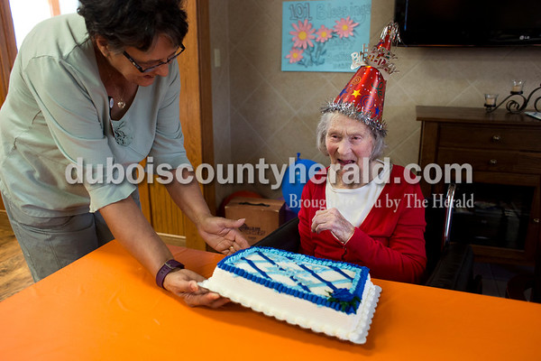 Activities assistant Debbie Wilson set down a cake as residents, employees and family gathered together on Tuesday afternoon to celebrate Dorothy Shnarr's 101st birthday at Northwood Retirement Community in Jasper. Schnarr was born on an 80-acre farm in Boone township and stayed on the property to work at the farm throughout her adult life. She lived with her niece and then her nephew for a few months, and then moved to Northwood at age 98. Her nephews Dean and Gary Schnarr of Boone township, and her niece Ruth Bush of Otwell remember her as a hard worker on the farm. The family raised hogs, cattle, and milk cows and farmed corn and soybeans. Dorothy always drove the tractor and Bush remembers seeing her aunt bouncing up and down when the tractor stalled going up the hills.  Alisha Jucevic/The Herald
