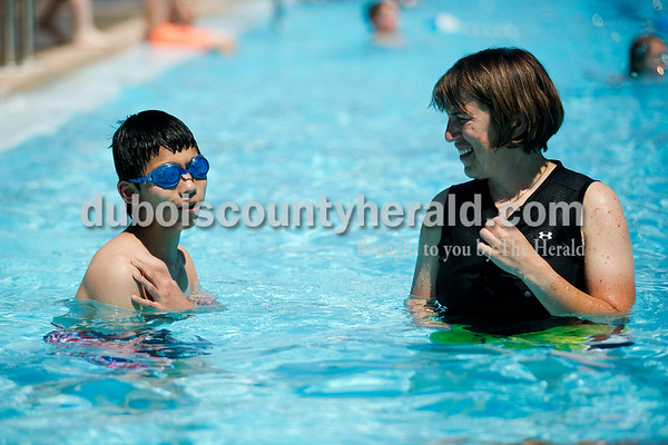 """Samuel and his mother, Ashlin, visited the Jasper Municipal Pool on June 10 with Samuel's brother Mathieu. """"His ability to adapt has been impressive to me,"""" Ashlin said. Still, there are challenges away from home. """"The things I've found most challenging are going out places that are not really equipped (for those with disabilities),"""" Ashlin said. Places like the Jasper Municipal Pool bring up many obstacles that she may have not have noticed before adopting Samuel. With long steps leading up to the pool and a male and female entrance, it makes it difficult to navigate."""