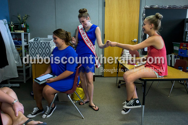Hannah Kress of Jasper, 14, handed bobby pins to Miss Indiana Senior Sweetheart 2016 Priscilla Olson of Ireland, 17, as Priscilla helped Colleen Hopf of Duff, 20, do her hair before the Miss Ireland Bicentennial Queen pageant on Sunday at Ireland Elementary School.  Alisha Jucevic/The Herald