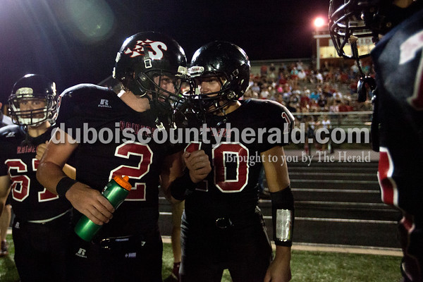 Southridge's Kortland Hartke, right, congratulated teammate Jayce Harter after a play during Friday night's game in Huntingburg. The Raiders defeated the Wildcats 28-21, securing the first rivalry win since 2008.  Alisha Jucevic/The Herald