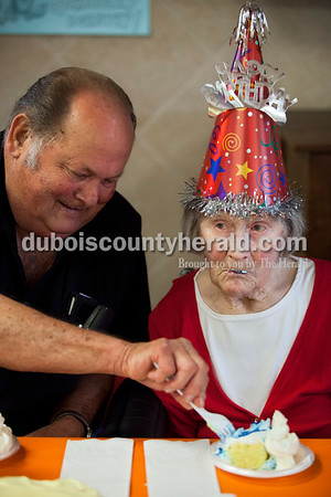 Gary Schnarr of Boone township helped his aunt, Dorothy Schnarr, try her birthday cake as residents and employees gathered together on Tuesday afternoon to celebrate Dorothy's 101st birthday at Northwood Retirement Community in Jasper. Schnarr was born on an 80-acre farm in Boone township and stayed on the property to work at the farm throughout her adult life. She lived with her niece and then her nephew for a few months, and then moved to Northwood at age 98. Her nephews Dean and Gary Schnarr of Boone township, and her niece Ruth Bush of Otwell remember her as a hard worker on the farm. The family raised hogs, cattle, and milk cows and farmed corn and soybeans. Dorothy always drove the tractor and Bush remembers seeing her aunt bouncing up and down when the tractor stalled going up the hills.  Alisha Jucevic/The Herald