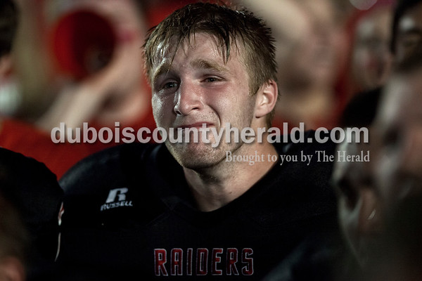 Southridge's Nathanial Pendley listened to coach Scott Buening after  Friday night's game in Huntingburg. The Raiders defeated the Wildcats 28-21, securing the first rivalry win since 2008.  Alisha Jucevic/The Herald