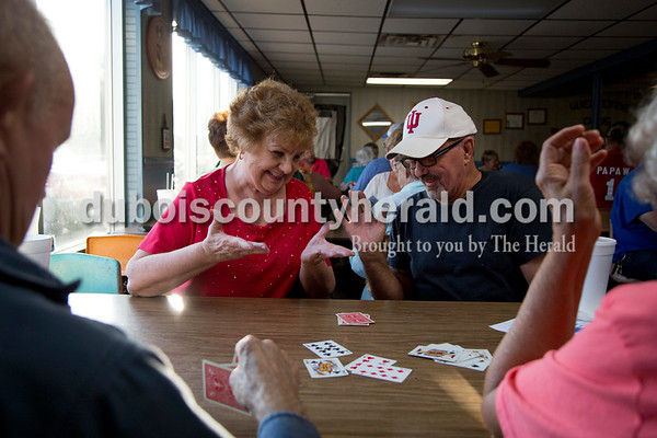 Sarah Shaw/The Herald Linda Atkins of Birdseye and James Huff of Bloomington joked around after a round of Euchre during the tournament at Deb's Truck Stop in Birdseye on Thursday. The Birdseye Picnic begins Friday afternoon and continues through Saturday.