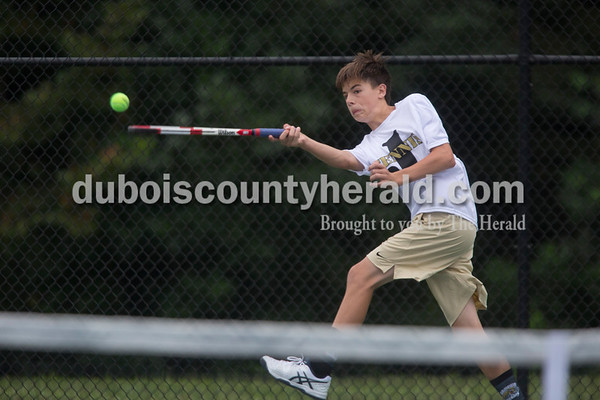 Sarah Shaw/The Herald Jasper's Michael Kluemper reached for a ball during the tennis invitational in Jasper on Saturday.