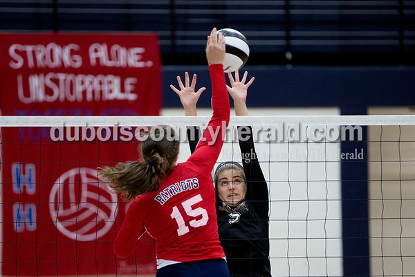 Sarah Shaw/The Herald Heritage Hills' Abby Wahl hit the ball over the net while Jasper's Kymber Schwenk defended during the game at Heritage Hills High School in Lincoln City on Tuesday. The Patriots beat the Wildcats three sets to none.