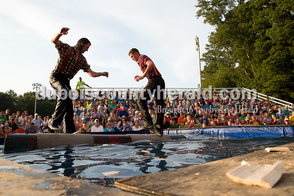 Professional lumberjacks and brothers Tyler Alden, left, and Logan Alden, both of Frederic, Wis. competed in logrolling during the Olympics of the Forest show at the Ireland Bicentennial celebration on Saturday. Sarah Ann Jump/The Herald