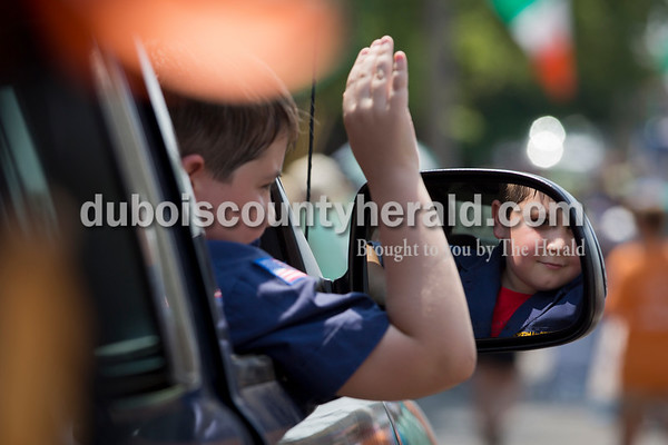 Boy Scout Reznor Blair of Jasper, 8, waved during the Ireland Bicentennial parade on Sunday. Sarah Ann Jump/The Herald