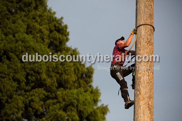 Professional lumberjack Logan Alden of Frederic, Wis. speed climbed a 45 foot pole during the Olympics of the Forest show at the Ireland Bicentennial celebration on Saturday. Sarah Ann Jump/The Herald