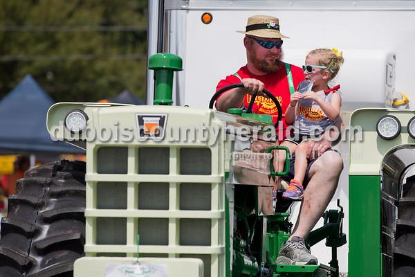 Brad Merkley of Ireland drove a tractor with his niece Brea Hardin, 2, during the Ireland Bicentennial parade on Sunday. Sarah Ann Jump/The Herald