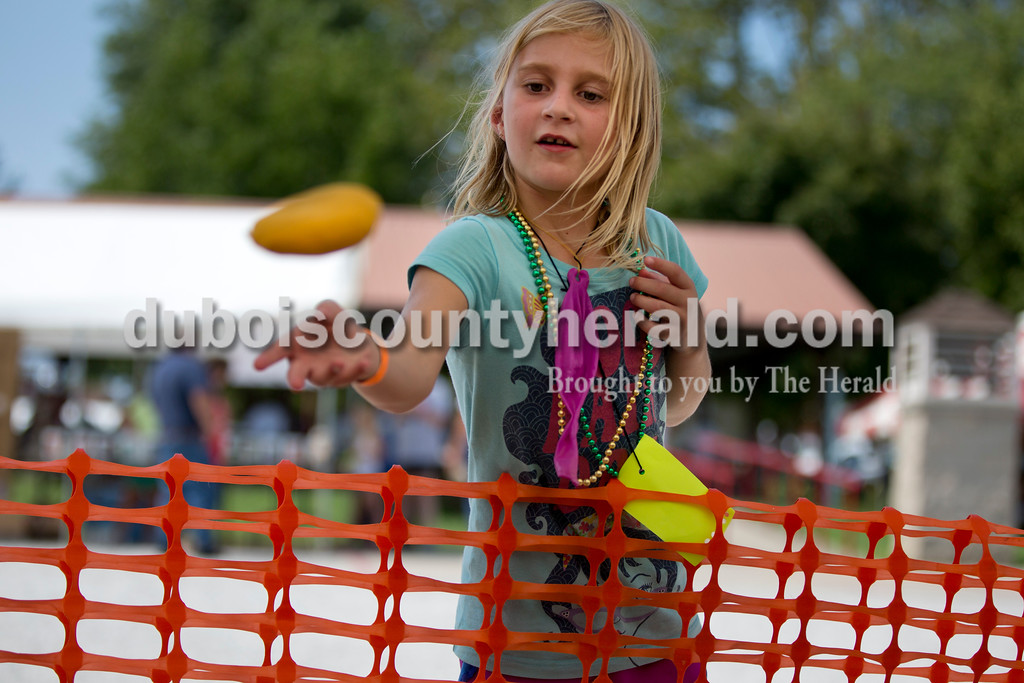 Sarah Shaw/The Herald<br /> Alexis Berg of Ferdinand, 6, tossed beanbags while playing a carnival game during the town of Birdseye's annual picnic at Birdseye Park on Saturday.